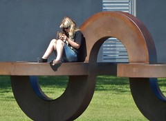 Art Climber (mikecogh) Tags: glenelg sculpture sitting checking phone publicart