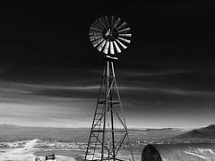 Desert Water (Chootzie) Tags: bw blackandwhite windmill nevada backroads ghost town winnemucca dry lake desert