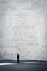 Standing in the shadows (The Green Album) Tags: architecture bricks man standing phone shadows light vast scale bilbao guggenheim