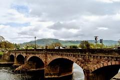 Bridge on River Wye, Monmouth (Manoo Mistry) Tags: river wye nikon nikond5500bodyonly tamron tamron18270mmzoomlens monmouth bridge sky mountain outdoor tourist town wales water