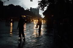 Before the storm (sanat_das) Tags: kolkata esplanade afternoon summer storm dark pedestrians vehicles lights overcast beforethestorm d800 50mm