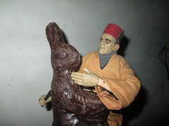Ardeth Bey / Imhotep the Mummy holding Easter Bunny Rabbit hostage 2017 NYC 4599 (Brechtbug) Tags: boris karloff ardeth bey imhotep mummy holding easter bunny rabbit hostage 2017 monster dusty action figure universal monsters new york city egypt egyptian pharaoh bandage wrapping wrapped ash covered ancient antediluvian archeology museum excavation pyramid sphinx tomb dig sand desert creature its alive scary horror terror halloween fright toy toys shadow twist corpse case mummies sarcophagus sideshow chocolate eeeaster