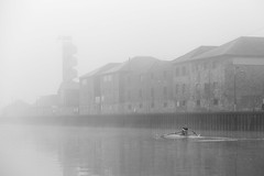 perseverance... (Vladimir Barvinek) Tags: perseverance rowing boat stamina river water stroke pace fog mist exe exeter building old quay history blackandwhite
