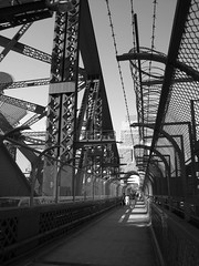 Sydney Harbour Bridge Australia (eriagn) Tags: people blackandwhite metal architecture canon fence walking photography shadows steel sydney australia pedestrian monotone icon walkway barbedwire sculptural protection iconic continent girders sydneyharbourbridge eriagn ngairelawson ngairehart