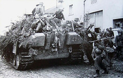 Panzergrenadiers prepare to move out to cover the advance of a Panther of Panzerbrigade 111 during the Battle of Arracourt