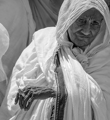 Pietà (ybiberman) Tags: old portrait bw hat israel candid jerusalem streetphotography oldwoman churchoftheholysepulchre oldcity alquds ethiopian easterweek deiralsultan legswashingceremony