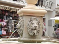 Av del Compas, Mijas - fountain with lion heads (ell brown) Tags: sculpture fountain sunglasses souvenirs spain balcony lion espana balconies costadelsol handbags andalusia malaga mijas mijaspueblo southofspain sierrademijasmountainrange avdelcompas