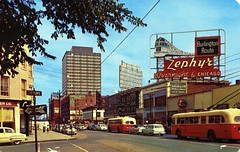 Broadway Looking North Denver CO (Edge and corner wear) Tags: street city railroad chicago bus sign st electric burlington vintage advertising design pc colorado downtown neon postcard main broadway denver advertisement route chrome zephyr storefront co shops stores 17th cheyenne overnight pantograph