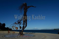 60072238 (wolfgangkaehler) Tags: 2016 southamerica southamerican latinamerica chile chilean southernchile town puertovaraschile view lakellanquihue lakedistrict osornovolcano lake mountain volcano waterfront art publicart sculpture sculptures metalart metalartwork metalsculpture metalsculptures woman