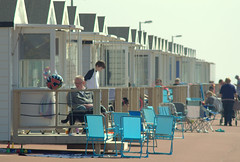 Beach huts at St Annes - 2 (Tony Worrall) Tags: north country place visit area county attraction open stream tour urban candid people person capture outside outdoors caught photo shoot shot picture captured picturesinthestreet photosofthestreet resort england english northwest town northern location lancs lancashire uk fylde fyldecoast stannes beach huts sunlit relax hut sunny holiday holidaytown beachhuts stannesbeachhuts