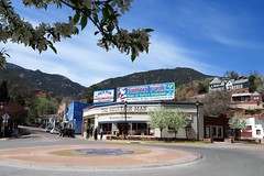 Springtime in Manitou (Patricia Henschen) Tags: manitousprings colorado spring blossoms flowers apple mountainman northpole sign santasworkshop trafficcircle pikespeak cog railway mountains mountain manitouavenue pathscaminhos