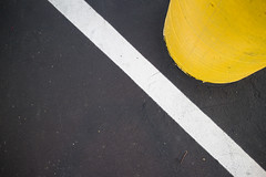 isolation (apg_lucky13) Tags: canon jdc jasdaco eosm2 ca usa white black yellow minimal abstract urban urbanlandscape asphalt urbanabstract parkinglot diagonal line curve jason outdoors