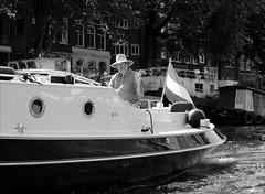 Captain Cool :-) (Gabi Wi) Tags: bw monochrome boat man cool captain hand gesture facialexpression salutation sw boot mann kapitän gestik mimik grus water wasser gracht