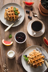 Breakfast table with waffles (Arx0nt.) Tags: breakfast topview coffee waffle stilllife background morning food healthy dessert sweet kiwi jam tasty blueberry instagram flower lunch sugar golden fruit eating syrup closeup grapefruit honey meal warm table berry milk plate delicious white spring red snack cup homemade gourmet cutlery belgian cream pastry fresh mint rustic