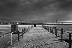 Two on the Gulf - Двое на заливе (Valery Parshin) Tags: russia saintpetersburg stpetersburg valeryparshin vasilyevskyisland sea pier bridge ice snow canoneos600d canonefs1018mmf4556isstm blackandwhite sepia gulfoffinland