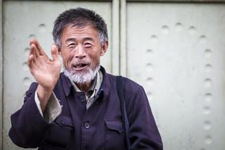 Waving Chinese man in Dali, China