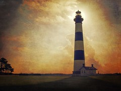 Bodie Lighthouse bathed in warm morning light (dqpagan) Tags: park nationalpark darecounty nc shore beach light sun clouds morning beauty art bodielighthouse bodie lighthouses lighthouse outerbanks banks outer obx