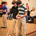 Students guide their hovercraft along the floor for the judges.