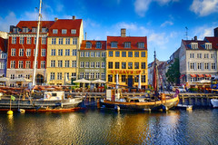 Ships at Nyhavn in Copenhagen, Copenhagen (` Toshio ') Tags: toshio copenhagen denmark europe european europeanunion nyhavn ship fishingboat tallship reflections clouds townhouses restaurant bar cafe water harbor buildings architecture fujixe2 xe2