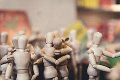 Let's All Get Along (Kevin VanEmburgh Photography) Tags: firstsaturday kansascity kevinvanemburghphotography midtown nikon saturday hug embrace wooden figures hugging kcmo