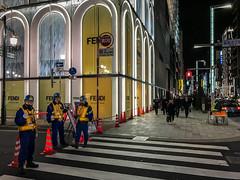 Tokyo Watchmen (USpecks_Photography) Tags: ginza tokyo japan street streetphotography workmen pedestrians nightphotography nightshots
