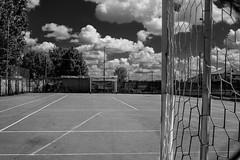Challenge (coachgodzup1) Tags: blackandwhite whiteandblack fujifilm fuji xt10 xf27mm football soccer field net clouds redfilter silverefex2