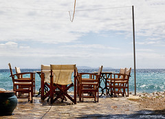 Terrace weather..... ;-) (Astrid Photography.) Tags: sea sky water clouds spring chairs terrace greece samos sushine bluesea pythagorion coth abigfave anawesomeshot astridphotography