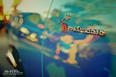 Mopar Magic (Hi-Fi Fotos) Tags: blue blur reflection vintage nikon classiccar bokeh cartoon plymouth american badge decal chrysler mopar roadrunner musclecar d5000 hallewell hififotos