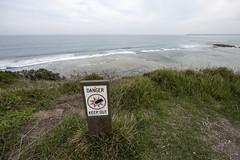 Fun at the beach. (eightythreephoto) Tags: ocean camera blue sea green grass sign danger warning canon photography photo war melbourne ww2 ww1 bomb weapons keepout worldwar1 photogragher 14mm 5dmkiii fortnapean
