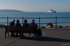 noyo-largs-1950 (Noyo Photography) Tags: largs lochshira ferry pensioners bench esplanade fence cumbrae clyde water coast fujifilms2pro fujifilms2 scotland