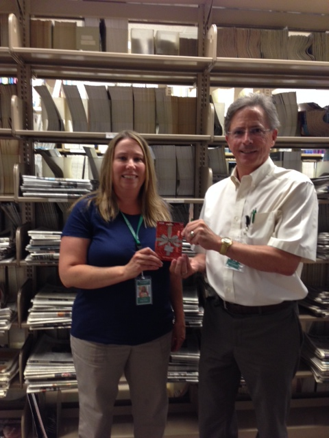 College of Health Professions Adjunct Instructor Denise Zavitsky accepts her $50 Gift Card from Library Director Jim McCloskey