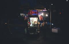 Early night snack (Jonathen Adkins) Tags: new york city nyc bridge people food brooklyn night hotdog downtown manhattan eat cart