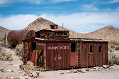 Old caboose in Rhyolite (koalie) Tags: vacation sky usa holiday clouds unitedstates desert nevada caboose ghosttown deathvalley rhyolite beatty familyvacation 2014california 2014springvacation