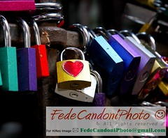 colored locks of love in the gate of the House of Romeo and Juliet (http://it.fotolia.com/p/202127813) Tags: italy house texture love sign metal wall closed mediterranean close place heart symbol background signature shakespeare security scene romance lovers autograph verona passion romeo romantic safe feeling sweetheart tight juliet drama padlock flirty juliette amore romeoandjuliet inlove attraction symbolism capulet passwords giulietta julietshouse accounts lucchetto symbolically