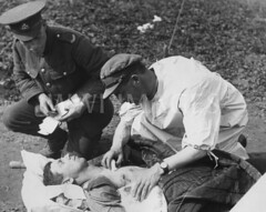 WWI1936N1 (ww1images) Tags: white station shirt soldier hit shot hole post notes chest wounded watch pad dressing pillow cap doctor blanket british bullet gown medic bandage injured gauze gunshot orderly tunic struck allied attend strecher