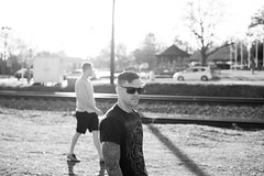 Roark_B&W (RedPhone_media) Tags: color d700 nikon suave shades sunglasses glass sun play outside composition lighting bokeh glare look side model man tattoos black white bw