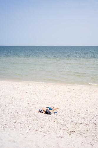 A man sun bathing