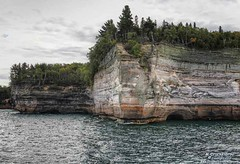 The Battleship Formation, Pictured Rocks National Lakeshore (PhotosToArtByMike) Tags: picturedrocksnationallakeshore michigan mi battleshiprock battleship picturedrocks upperpeninsulaofmichigan upperpeninsula up sandstonecliffs uppermichigan lakesuperior munising autumn autumnleaves rockycoastline mineralstain mineralstreaks seacave