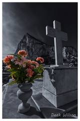 Flowers For The Lady (D.K.o.w) Tags: selectivecolouring cross grave graveyard cemetery headstone flowers gibraltar northfrontcemetery rock blackandwhite mono canon7dmkii sigma 1020 wide angle