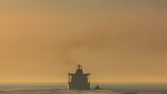 IJmuiden Misty sunset (tribsa2) Tags: nederlandvandaag marculescueugendreamsoflightportal sunset sunrisesunset sky seaside seascape shoreline sea ship schip schepen vessel
