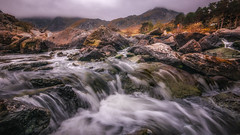 Cold water mountain (Einir Wyn Leigh) Tags: mountain landscape springtime water waterfall river rugged orange gold cloud storm rain outside outdoor valley wales cymru longexposure digital nikon