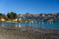 No One About (Jocey K) Tags: newzealand southisland canterbury akaora bankspeninsula sky akaoraharbour hills sea sand boats reflections scene lighthouse trees