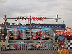 Speedway Carnival Ride. (dccradio) Tags: carnival trees light sky tree wisconsin fence fun lights evening cloudy overcast event entertainment ap nascar rides midway carride speedway carnivalride thrillride carnivalrides amusementrides springcarnival zamperla communityevent mechanicalride carnivalmidway centralwisconsin amusementdevice zamperlarides apshows apenterpriseshows apcarnival ridefence racingride zamperlamanufacturing zamperlaindustries zamperlamfg