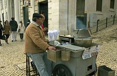 Roasted Chestnuts Seller (Amrico Aperta) Tags: city cidade portugal vendedor europa europe raw lisboa lisbon capital eu chestnuts p roastedchestnuts seller ue castanhas castanhasassadas panasonicdmcgf1 amricoaperta 1100154