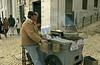 Roasted Chestnuts Seller (Américo Aperta) Tags: city cidade portugal vendedor europa europe raw lisboa lisbon capital eu chestnuts p roastedchestnuts seller ue castanhas castanhasassadas panasonicdmcgf1 américoaperta 1100154