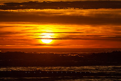 A Glorious Dawn (Fernandez Barrett) Tags: newzealand sky sun beach clouds sunrise canon dawn golden waves canterbury nz southisland dslr goodmorning daybreak sumner sumnerbeach skycloudssun canoneos7d