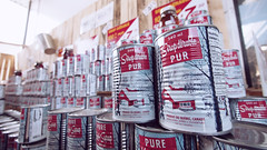 Obligatory maple syrup image (Eric Flexyourhead) Tags: city urban canada detail montral market quebec bokeh canned cans littleitaly maplesyrup 169 fragment