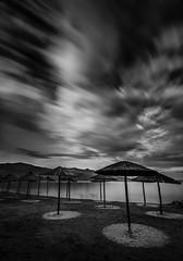 Waiting for summer II (ilias varelas) Tags: longexposure sea sky blackandwhite bw seascape beach water monochrome clouds canon umbrellas canonef1740mmf4l canoneos6d