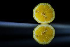 Lemangarin (D J Millard) Tags: orange macro reflection fruit lemon cut mandarin