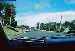 The road ahead (Luke Jacob Simon) Tags: road blue original sky sun film car clouds analog 35mm canon person photography kodak ae1 first australia ishootfilm 400 program windshield forward ultramax